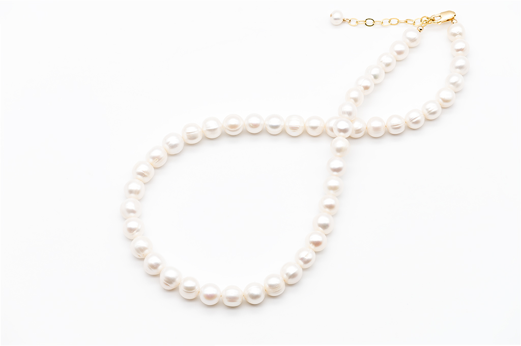 Baltās apaļās formas pērles