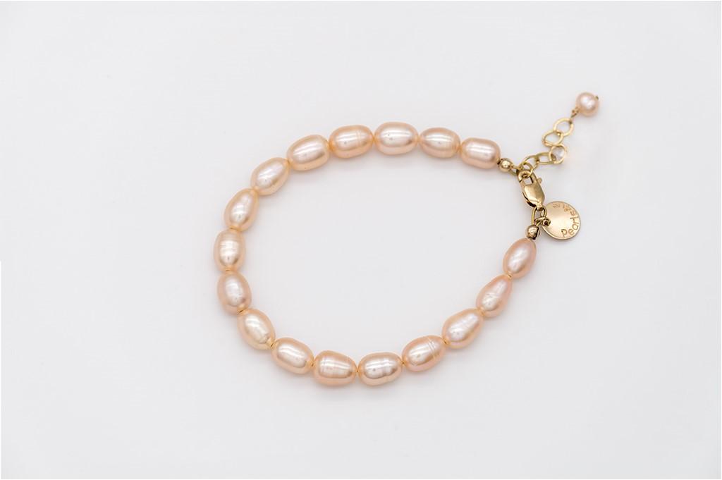 Rīsu formas aprikožu toņa pērles