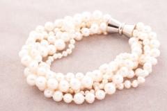 Balto lielo pērļu rokassprādze