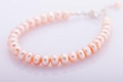 Lašu krāsas pērles