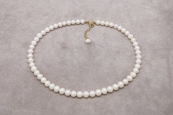 Strand of golden pearls