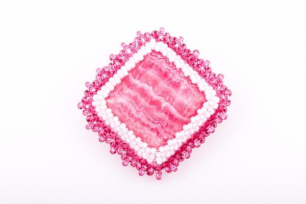 Pink stone brooch