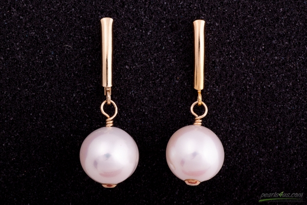 Near round white pearls earrings